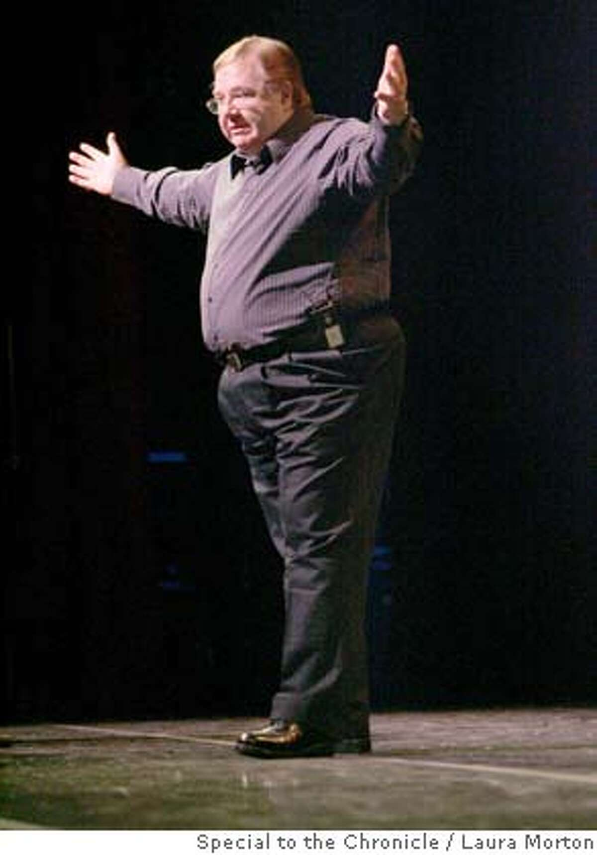 Spiritual medium Robert Brown speaks to the crowd at Proof of an Afterlife, a conference held at the Fort Mason Center in San Francisco. The conference focused on the afterlife sciences. (Laura Morton/Special to the Chronicle)