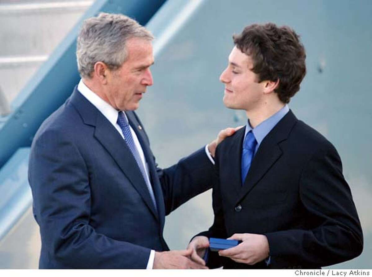 President George Bush presents Richard Berwick, 18, with the President's Volunteer Service Award when he arrives flies Wed. January 30, 2008, in San Francisco, CA. (Lacy Atkins San Francisco Chronicle)