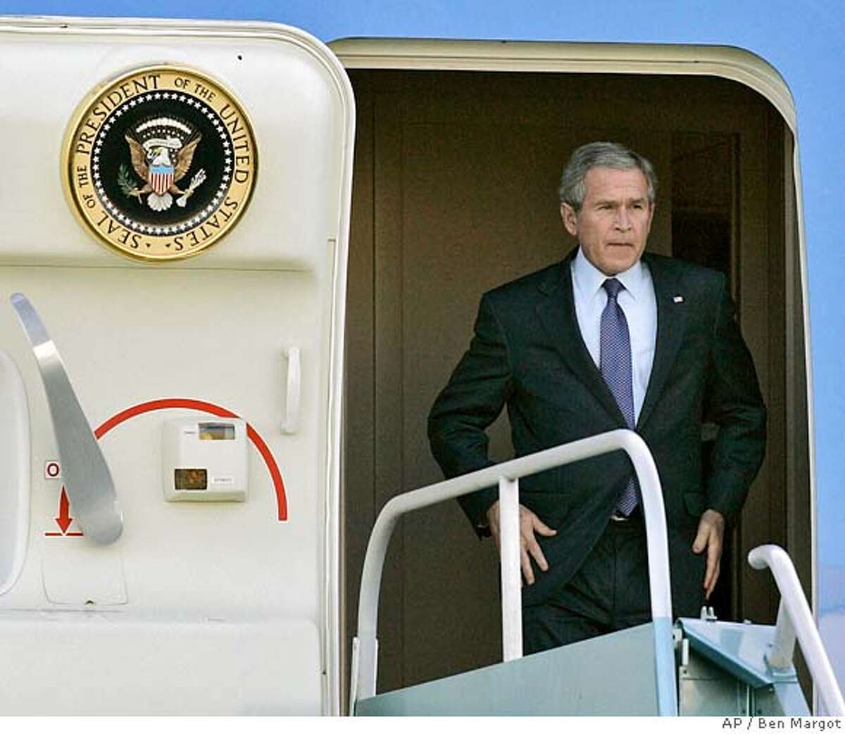 President George Bush disembarks Air Force One Wednesday, Jan. 30, 2008, in San Francisco, Calif. (AP Photo/Ben Margot)