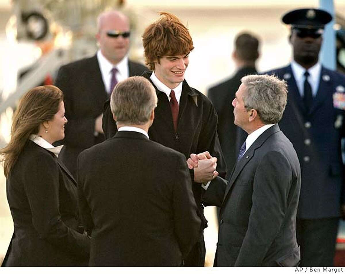 President Bush, right, shakes hands with Amador Valley High School student Kevin Laue, center, as Laue's mother Jodi Jarnagin, left, and father Jim, right, look on Wednesday, Jan. 30, 2008, in San Francisco. Laue, a one handed basketball player, was present to greet the President to the San Francisco Bay Area. (AP Photo/Ben Margot)