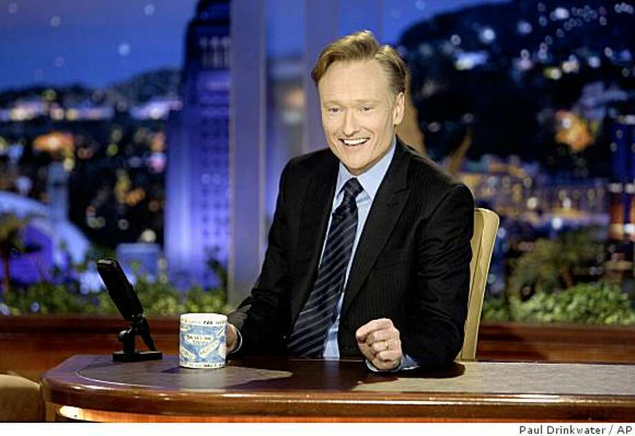 "In a photo provided by NBC Conan O'Brien  makes his debut as the host of NBC's ""The Tonight Show"" Monday June 1, 2009  in Universal City, Ca. Photo: Paul Drinkwater, AP"