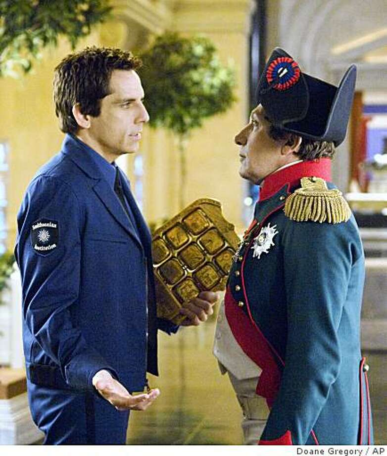In this film still from the movie, Night at the Museum: Battle of the Smithsonian, released by Twentieth Century Fox Film Corporation, Larry Daley, played by Ben Stiller, left, has a heart-to-heart with Napoleon, played by Alain Chabat, about the latter's plans for world domination. Photo: Doane Gregory, AP