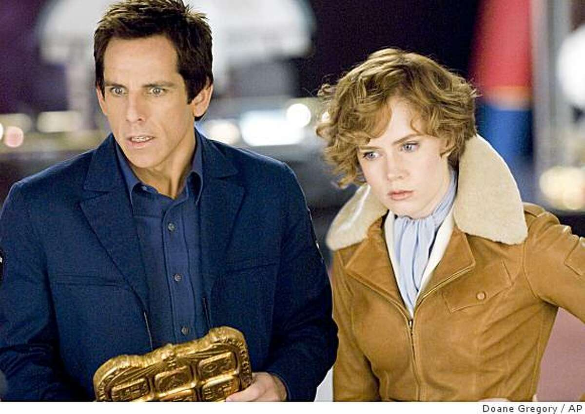 In this film publicity image released by 20th Century Fox, Ben Stiller and Amy Adams are shown in a scene from