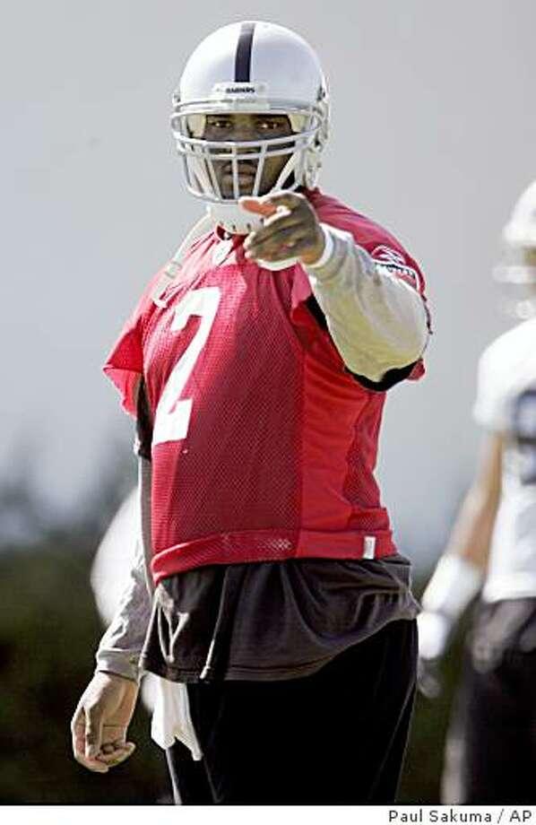 Oakland Raiders quarterback JaMarcus Russell (2) points during practice at Raiders headquarters in Alameda, Calif., Wednesday, May 20, 2009. Photo: Paul Sakuma, AP