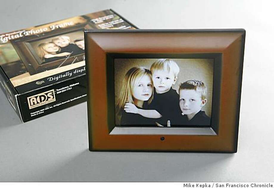 "In 2007, Sam?s Club  also sold infected frames over the holidays, according to customers who bought them, as did Best Buy, Target and Costco. Sold at Sam's Club, the ADS Digital Photo Frame - 8"" has reportedly been the vector for cases of malware after a Bethesda research institute specializing in information security reported cases of computers being infected by digital photo frames. Mike Kepka / The Chronicle Photo: Mike Kepka, San Francisco Chronicle"