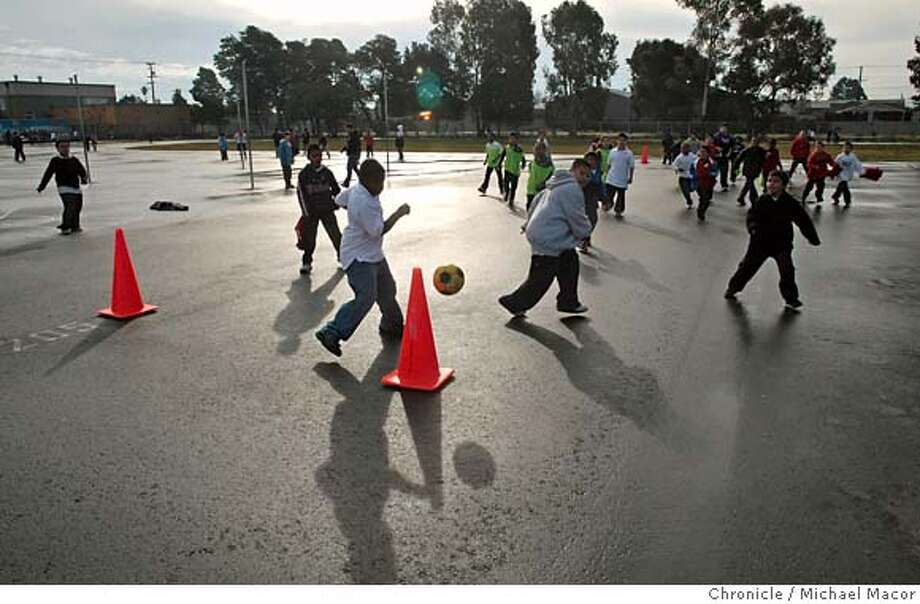 play24_048_mac.jpg A soccer game on the blacktop area takes place during recess. The students at Lincoln Elementary School in Richmond, Ca., don't go out on the weekends to play tag or skip rope, it's too dangerous. Evelia Ramirez, a Sports 4 Kids coach is in the process of teaching the kids how to play with sports programs during the school's recess time. Michael Macor / The Chronicle Taken on 1/23/08, in Richmond, CA, USA MANDATORY CREDIT FOR PHOTOG AND SAN FRANCISCO CHRONICLE/NO SALES-MAGS OUT Photo: Michael Macor