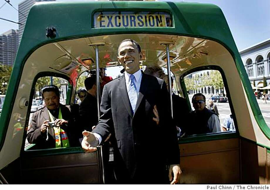 A wax likeness of President Barack Obama is loaded onto an open-air Muni streetcar for a short ride to the Wax Museum in San Francisco, Calif., on Thursday, May 21, 2009. Photo: Paul Chinn, The Chronicle