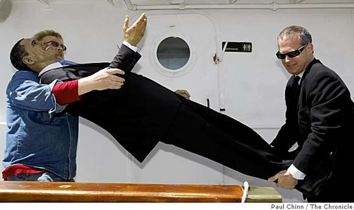 A wax likeness of President Barack Obama is carried off the USS Potomac by Wax Museum curator Curtis Huber (left) and James Teiser, who portrayed Obama's Secret Service agent, in San Francisco, Calif., on Thursday, May 21, 2009.