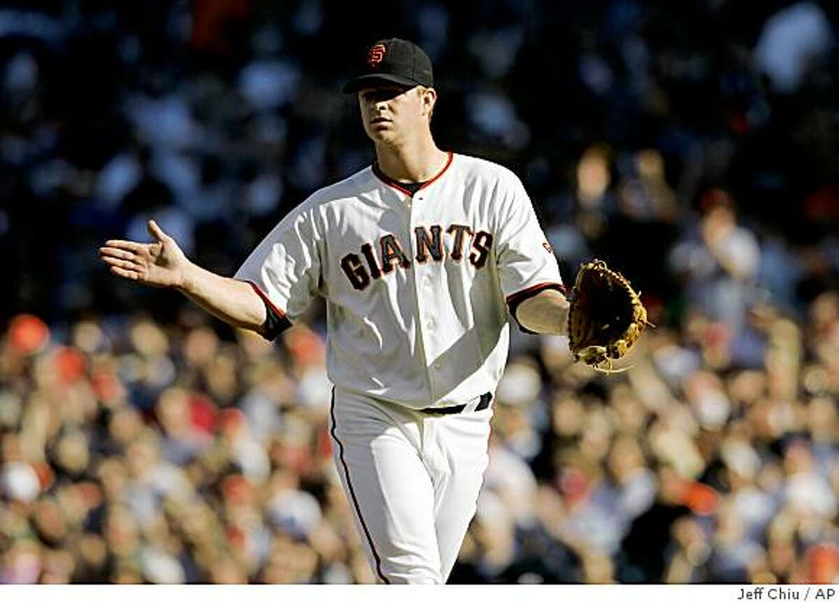 San Francisco Giants' Matt Cain celebrates after New York Mets pitcher Mike Pelfrey grounded out for the third out in the second inning of a baseball game in San Francisco, Sunday, May 17, 2009. The Giants won, 2-0. Cain was the winning pitcher. (AP Photo/Jeff Chiu)