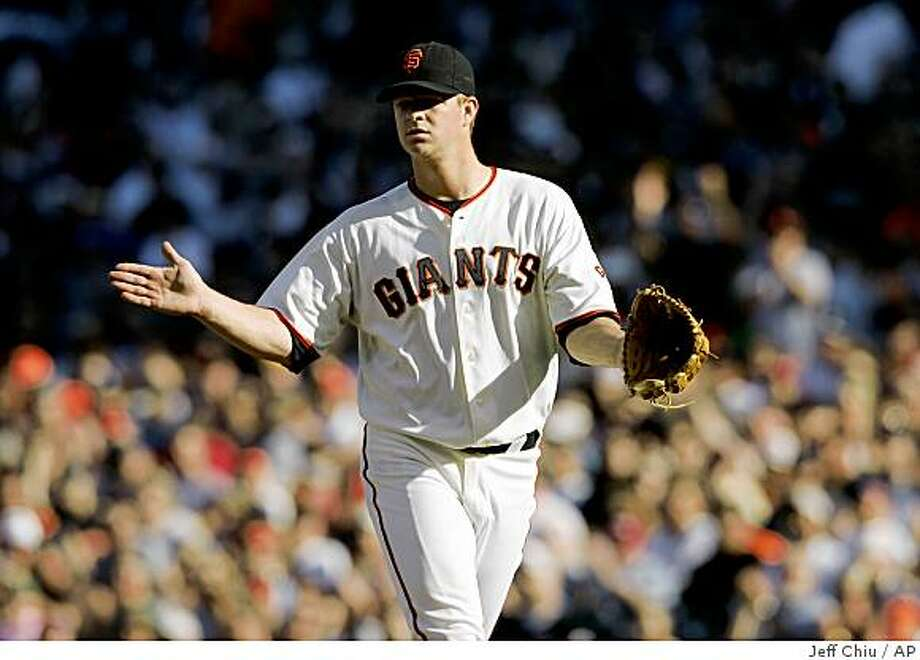 San Francisco Giants' Matt Cain celebrates after New York Mets pitcher Mike Pelfrey grounded out for the third out in the second inning of a baseball game in San Francisco, Sunday, May 17, 2009. The Giants won, 2-0. Cain was the winning pitcher. (AP Photo/Jeff Chiu) Photo: Jeff Chiu, AP
