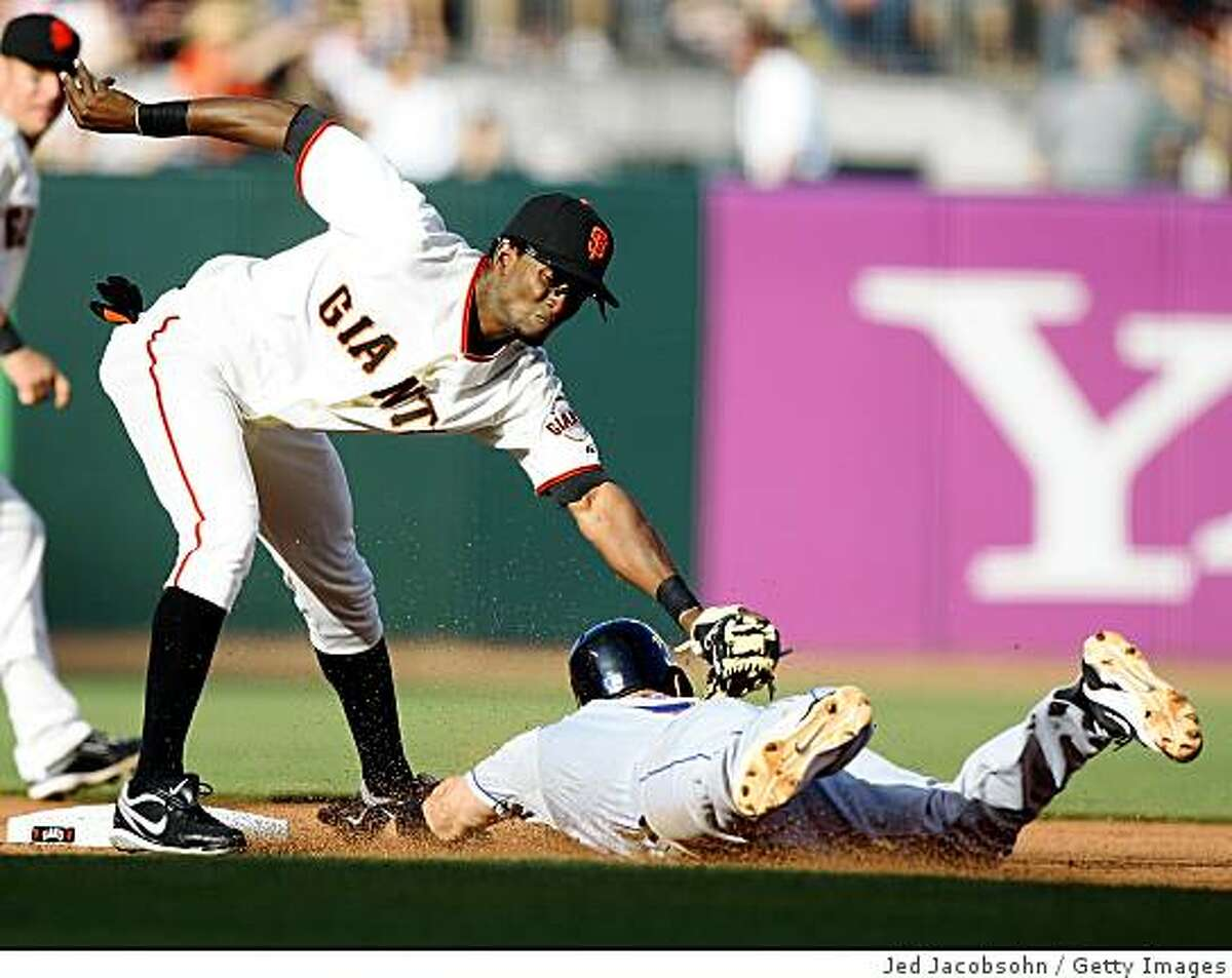 SAN FRANCISCO - MAY 17: Eugenio Velez #8 of the San Francisco Giants tags out David Wright #5 of the New York Mets on a steal attempt in the fourth inning during a Major League Baseball game on May17, 2009 at AT&T Park in San Francisco, California. (Photo by Jed Jacobsohn/Getty Images)