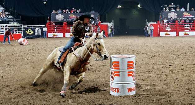 Nikki Steffes, of Vale, S.D., competes in the barrel racing event during the San Antonio Stock Show & Rodeo on Thursday, Feb. 9, 2012 at the AT&T Center. Steffes knocked over a barrel for a penalty, her time was 19.40. Photo: EDWARD A. ORNELAS, San Antonio Express-News / © SAN ANTONIO EXPRESS-NEWS (NFS)