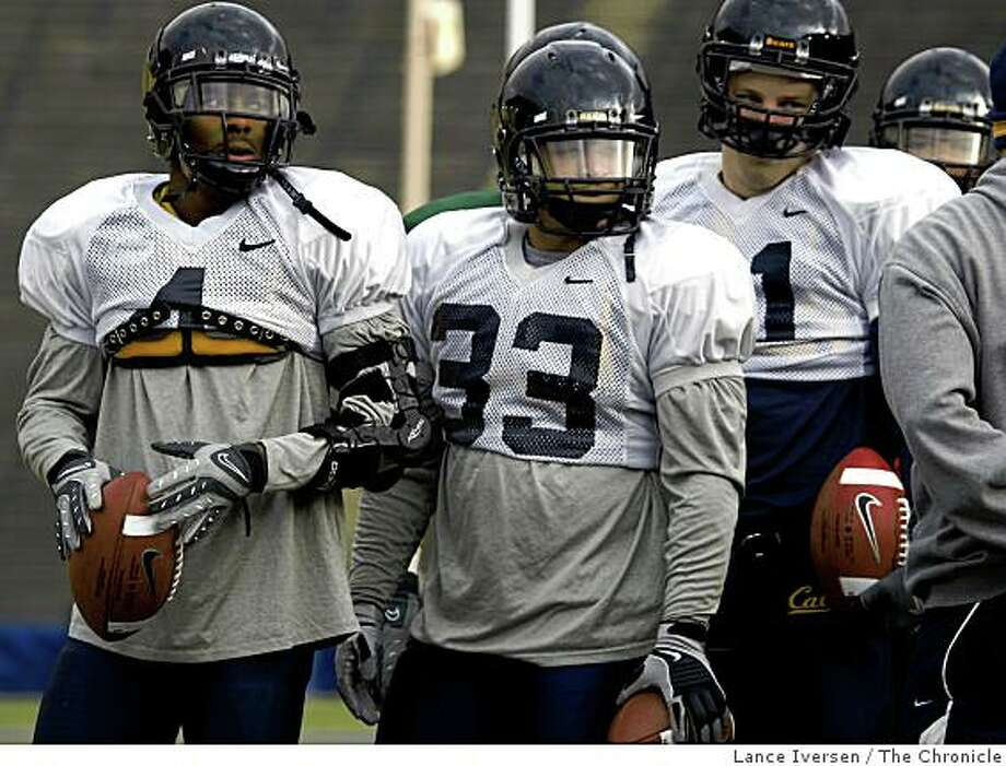 California running backs: Jahvid Best left and Brian Holley: listen to instructions from coach Ron Gould during team practice, as Cal prepares for the Emerald Bowl and The Miami Hurricanes. Thursday Dec 18, 2008. Photo: Lance Iversen, The Chronicle