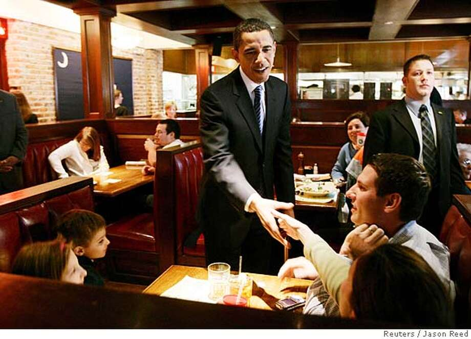 U.S. Democratic Presidential candidate Barack Obama (D-IL) greet diners during his visit to Harper's Restaurant in Columbia, South Carolina, January 26, 2008 of the day of South Carolina's Presidential Primary. REUTERS/Jason Reed (UNITED STATES) US PRESIDENTIAL ELECTION CAMPAIGN 2008 (USA) Photo: JASON REED