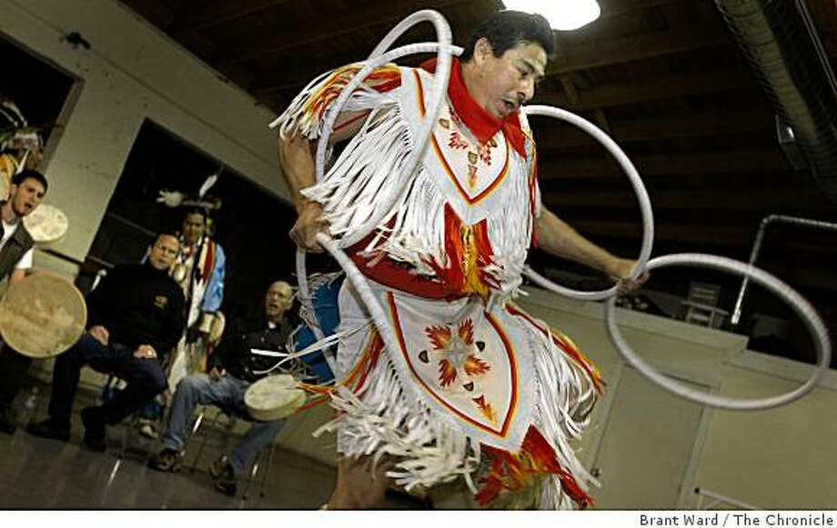 Tony Fuentes performs a hoop dance with the drum group, the Sweetwater Singers. Four Winds, an American Indian dance group, will be performing at the SF Ethnic Dance Festival in June, 2009. Photo: Brant Ward, The Chronicle