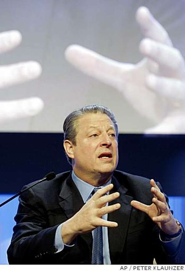 Former US-Vice President, Nobel Peace laureate Al Gore, speaks during a  plenary session on the second day of the Annual Meeting of the World Economic Forum, WEF, in Davos, Switzerland, Thursday, Jan 24, 2008. Top business leaders, heads of state from around the world as well as representatives of NGOs will gather here until Sunday, Jan. 27. (AP Photo/Keystone, Peter Klaunzer) Photo: PETER KLAUNZER, AP
