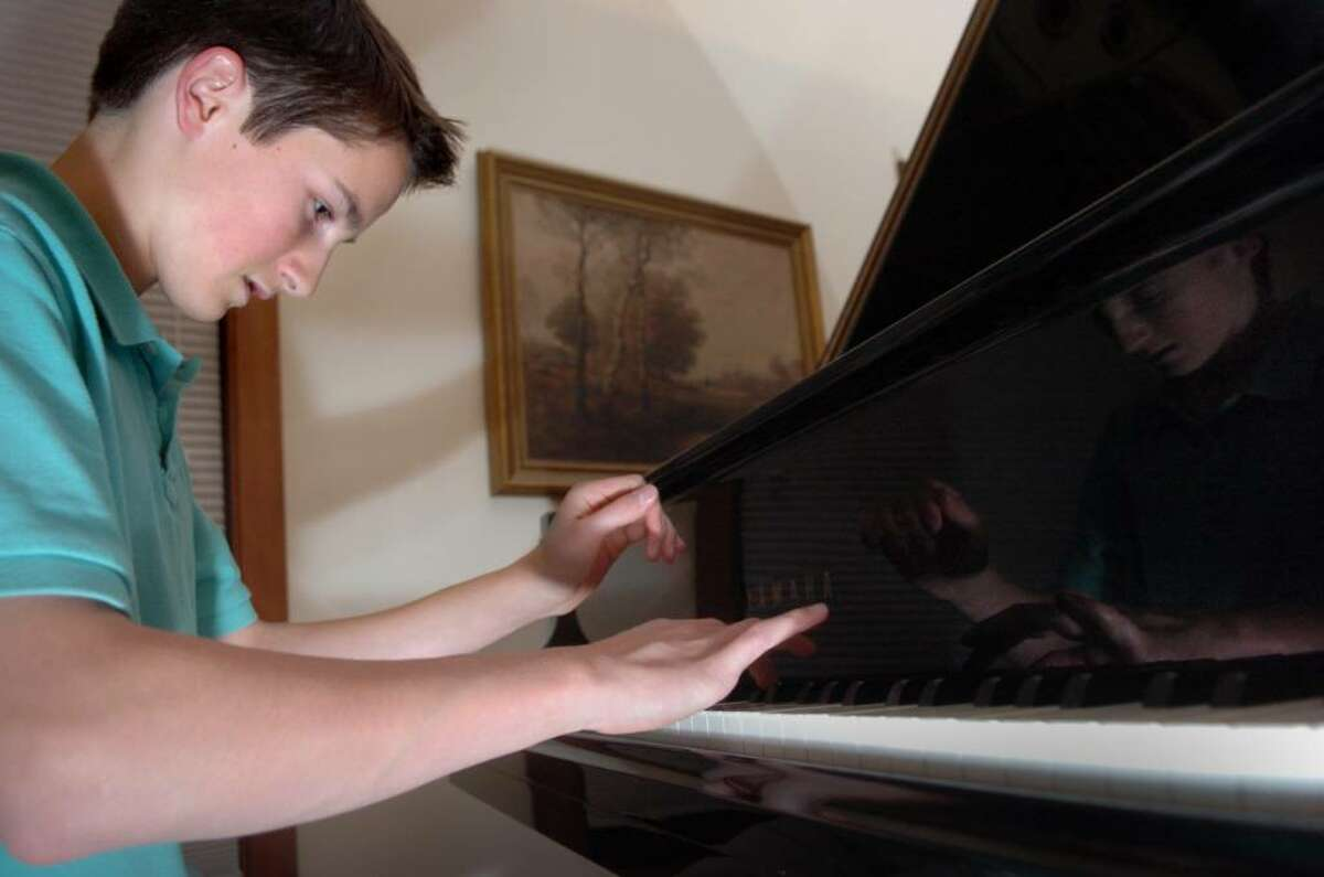 Fifteen-year-old Alex Beyer plays the piano in his Fairfield home. The young musician will make his professional debut with the Greater Bridgeport Symphony on Saturday Nov. 14, 2009.