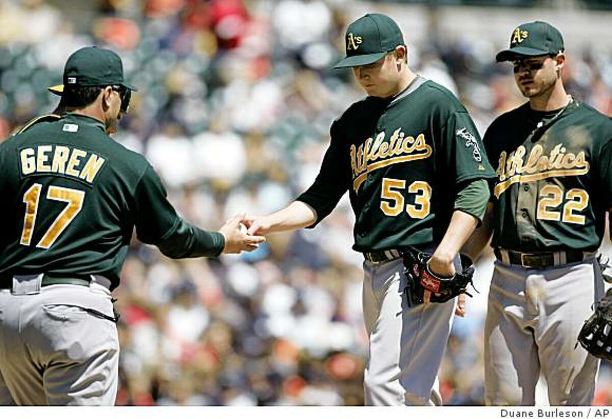 Oakland Athletics starter Trevor Cahill (53) is pulled by manager Bob Geren (17) as third baseman Jack Hannahan (22) looks on in the third inning of a baseball game Sunday, May 17, 2009, in Detroit. Cahill gave up seven runs on seven hits in a 11-7 loss to the Tigers. (AP Photo/Duane Burleson)