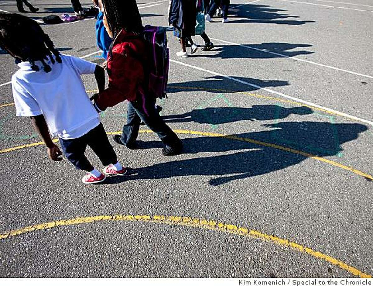 Students walk in the playground before school begins at Dr. George Washington Carver School in San Francisco, Calif., on Tuesday, May 26, 2009.