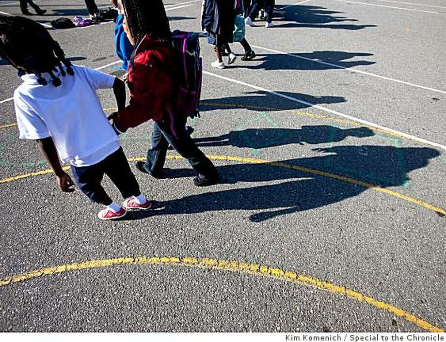 Students walk in the playground before school begins at Dr. George Washington Carver School in San Francisco, Calif., on Tuesday, May 26, 2009. Photo: Kim Komenich, Special To The Chronicle