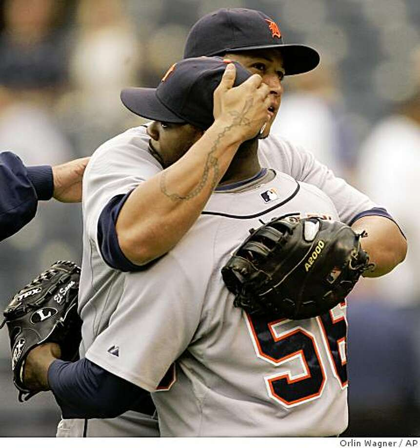 Detroit Tigers relief pitcher Fernando Rodney (56) is congratulated by teammate Miguel Cabrera following a baseball game against the Kansas City Royals in Kansas City, Mo., Wednesday, May 27, 2009. The Tigers defeated the Royals 8-3. (AP Photo/Orlin Wagner) Photo: Orlin Wagner, AP