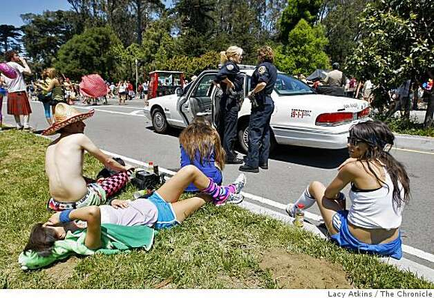 San Francisco Police Officers respond to a call by the Park Police when a young man refused to give up his bottle before entering Golden Gate Park during the Bay to Breakers. Photo: Lacy Atkins, The Chronicle
