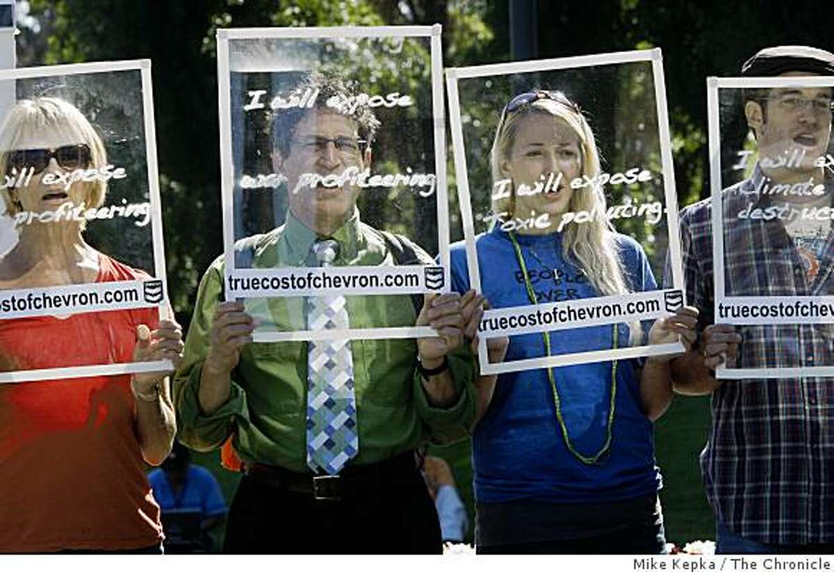 Janet Anderson, Michael Beer, Jennifer Falk and Brandon Erikson join other activists who staged a protest outside the gates of Chevron Headquarters during the annual shareholders meeting on Wednesday May 27, 2009 in San Ramon, Calif. Protester were comprised of several environmental and human rights groups blasting the company's actions in Richmond, Calif, Ecuador, Burma and Nigeria.