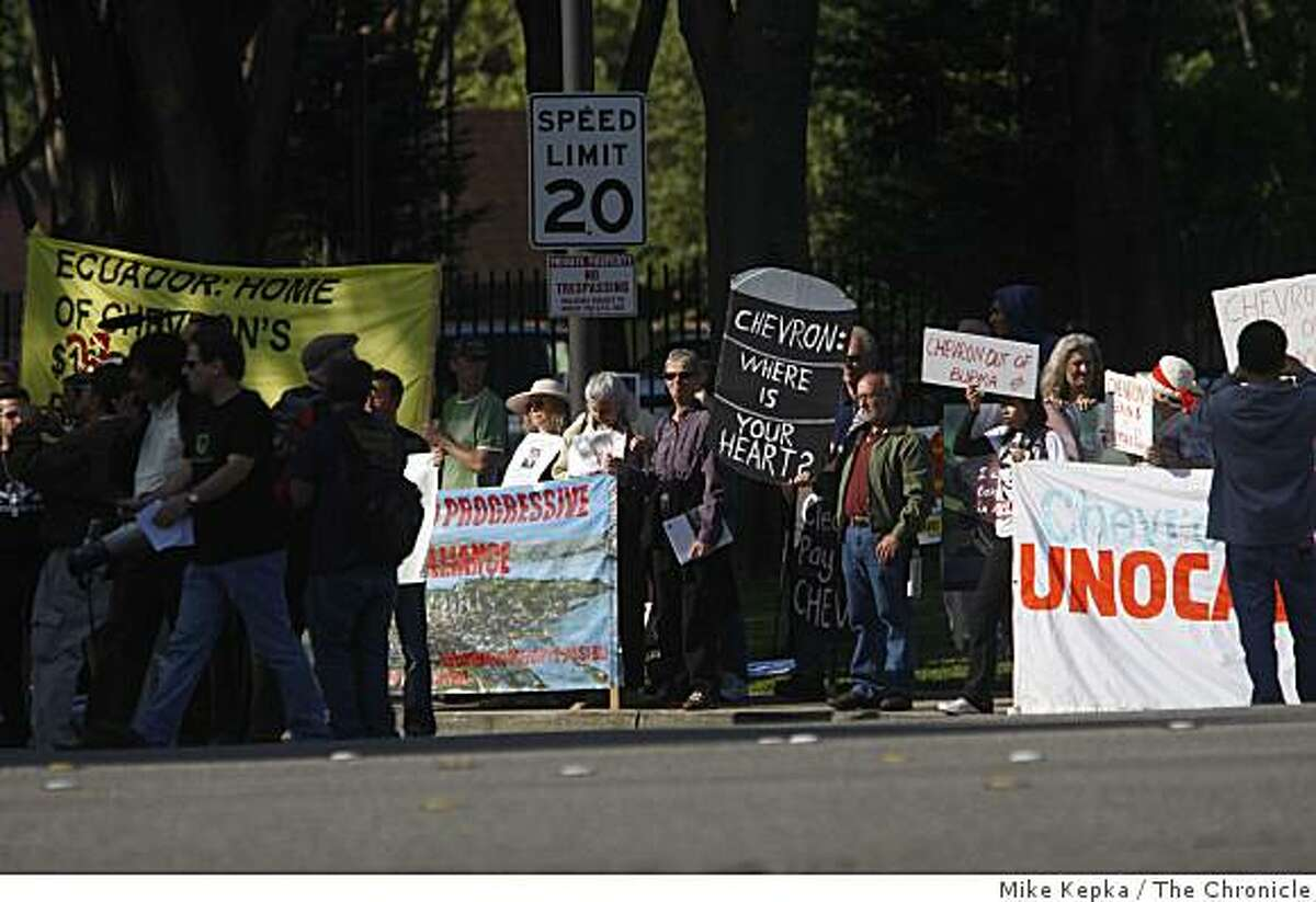 Activists stage a protest outside the gates of Chevron Headquarters during the annual shareholders meeting on Wednesday May 27, 2009 in San Ramon, Calif. Protester were comprised of several environmental and human rights groups blasting the company's actions in Richmond, Calif, Ecuador, Burma and Nigeria.