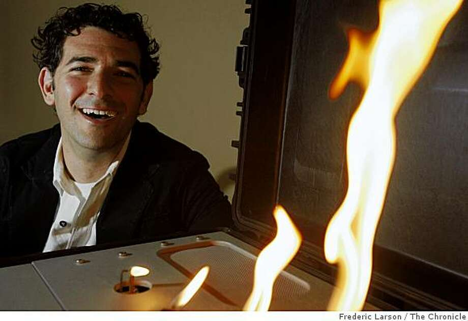 "Brett Levine owns a new San Francisco-based company, LiveSpark, where he invented a way to computerize gas-powered fireplaces to make the flames ""dance"" in time to music on May 22, 2009. Photo: Frederic Larson, The Chronicle"