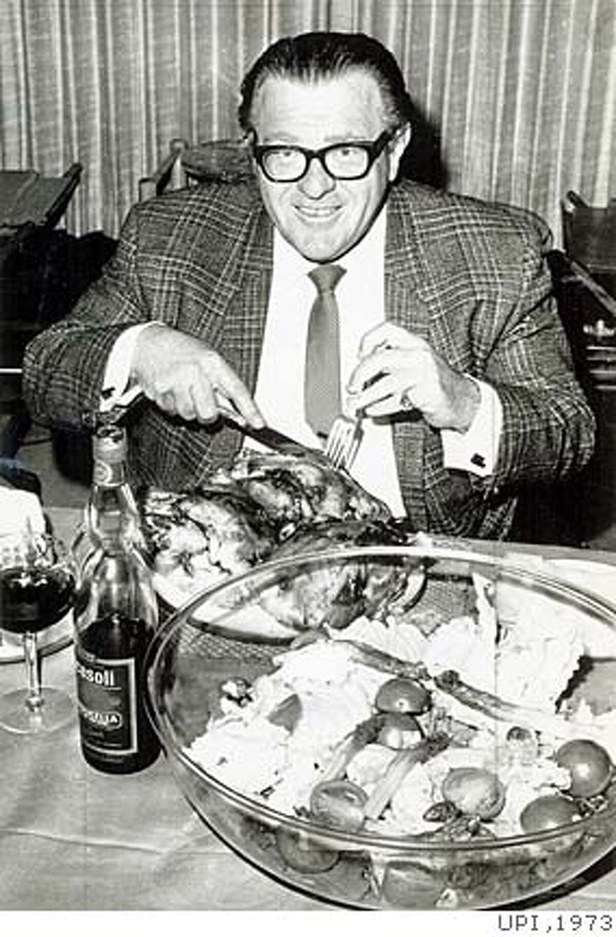"""Eddie """"Bozo"""" Miller enjoys a meal. He held records for eating 27 chickens at a sitting and drinking two quarts of liquor in an hour. UPI photo, 1973"""