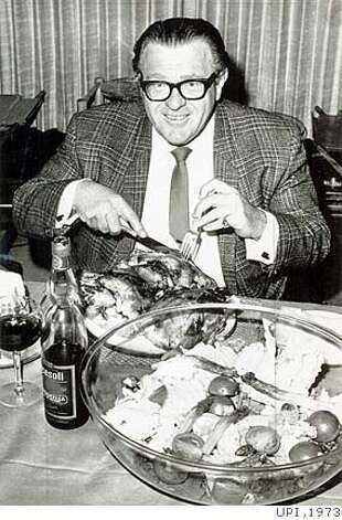 "Eddie ""Bozo"" Miller enjoys a meal. He held records for eating 27 chickens at a sitting and drinking two quarts of liquor in an hour. UPI photo, 1973"