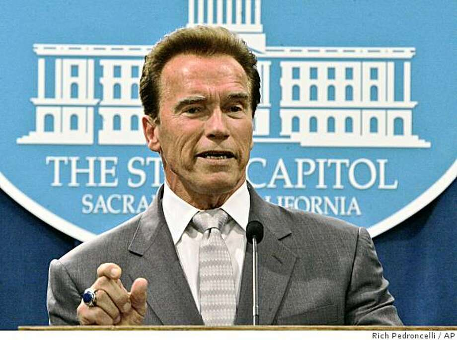 Gov. Arnold Schwarzenegger gestures as he discusses this revised state budget proposal for the coming fiscal year during a Capitol news conference in  Sacramento, Calif., Thursday, May 14, 2009.  Schwarzenegger called for laying off thousands of state employees and slashing billions from education to deal with a projected budget deficit that could go as high as $21.3 billion if voters reject the budget-related measures on next weeks special election ballot.(AP Photo/Rich Pedroncelli) Photo: Rich Pedroncelli, AP