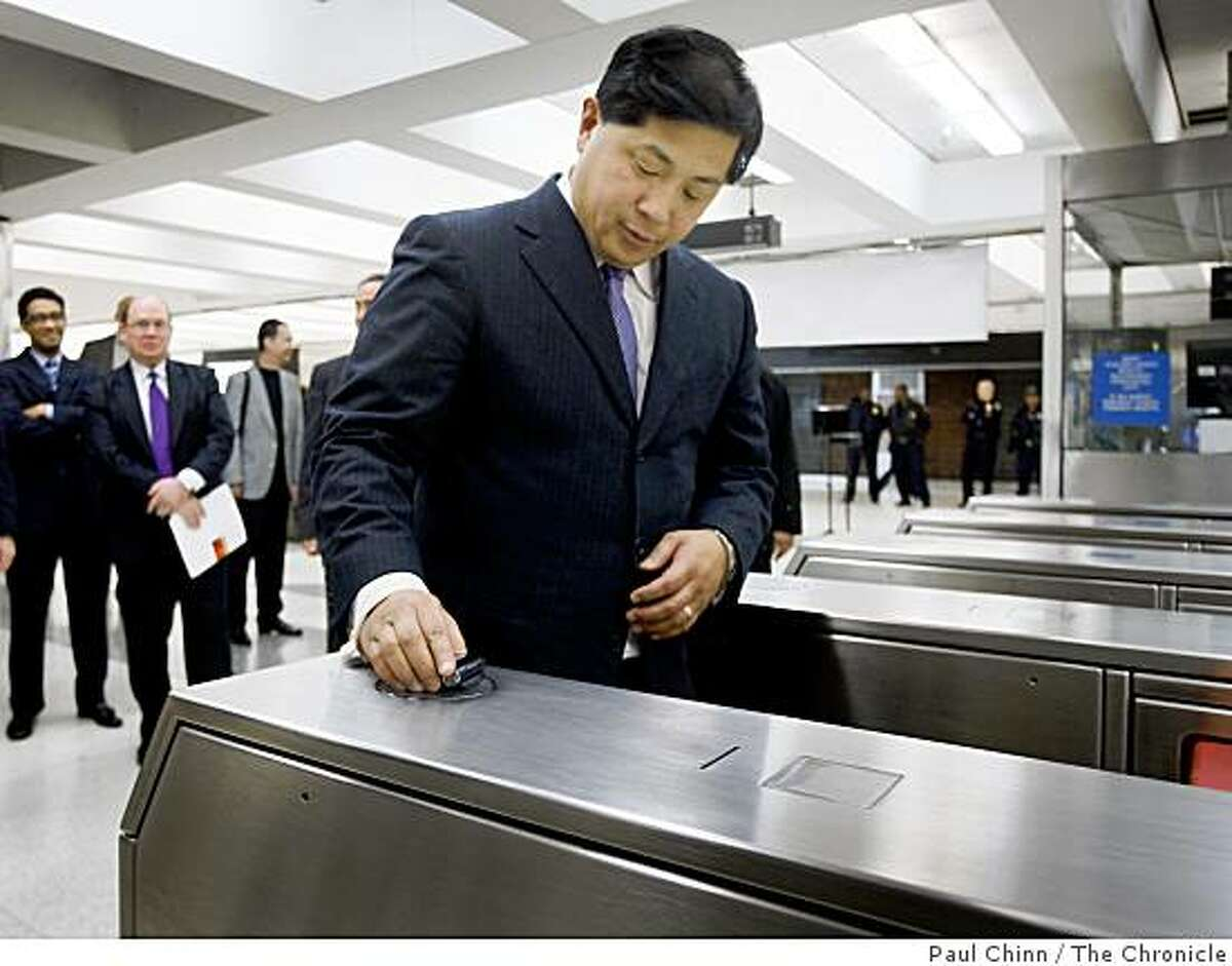Director James Fang used his cellphone to enter the BART system after the transit agency announced a new way to pay fares using specially equipped cellphones at a news conference at the Powell Street station in San Francisco, Calif. on Tuesday, Jan. 29, 2008. In a partnership with Sprint and First Data, commuters swipe their phones over a sensor on the fare gates which collect the data using Near Field Communication technology.