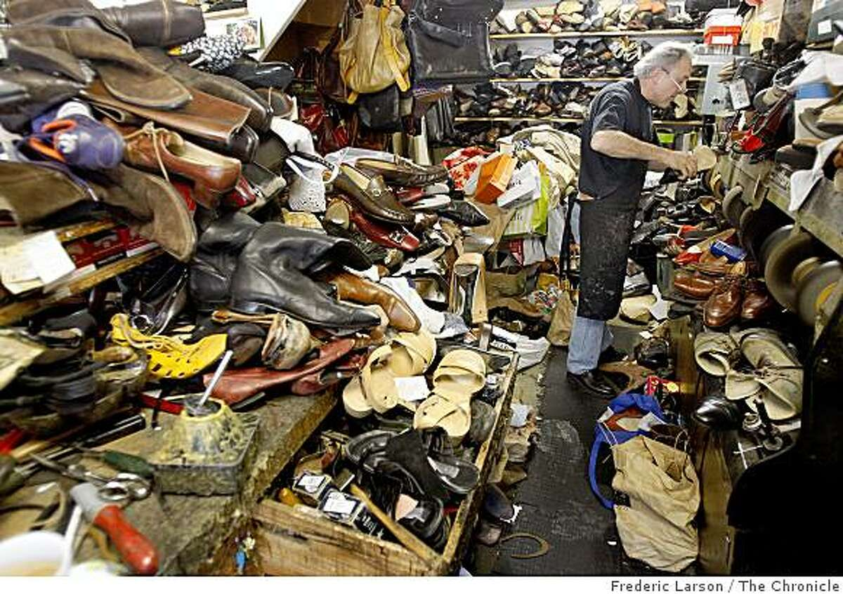 Misak Pirinjian who owns Tony's Shoe and Luggage repair shop in Mill Valley, California is surrounded by hundreds of shoes that need repair. Tony's is a very popular spot now-a-days during this economy since people are are more likely to repair then buy new shoes.