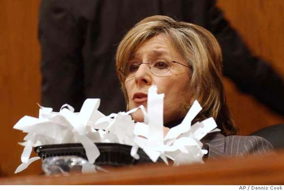 Senate Environment and Public Works Committee Chairman Sen. Barbara Boxer, D-Calif., holds tape which covered correspondence the committee received from the EPA during a hearing of the committee on Capitol Hill in Washington, Thursday, Jan. 24, 2008, to discuss California's request for a greenhouse gas waiver. (AP Photo/Dennis Cook) Photo: Dennis Cook