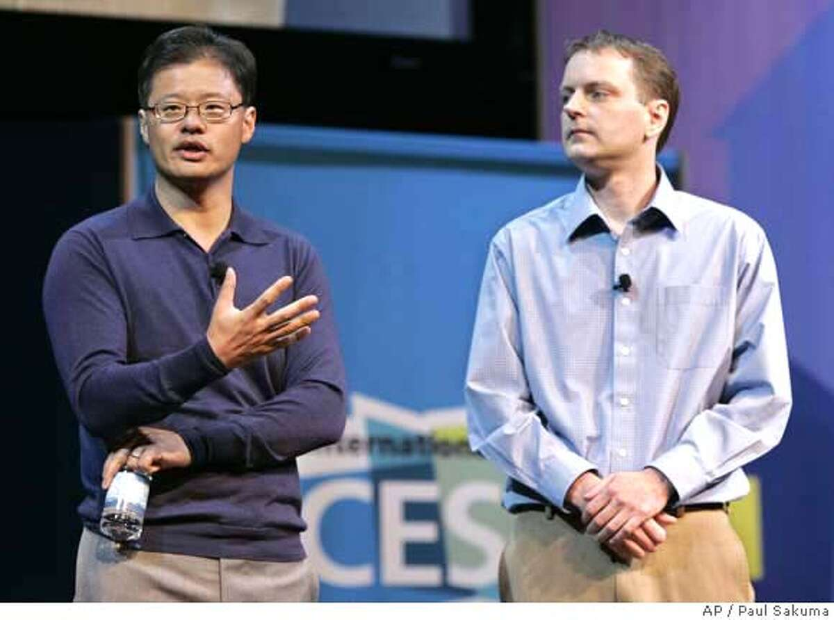 Yahoo CEO Jerry Yang, left, gives a keynote address as Yahoo co-founder David Filo, right, listens at the Consumer Electronics Show (CES) in Las Vegas, Monday, Jan. 7, 2008. (AP Photo/Paul Sakuma)