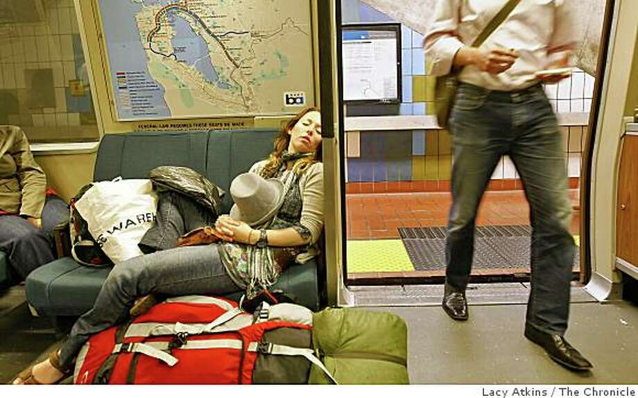 Travelers Stephanie McGrory  sleeps as she rides  BART to San Francisco from SFO on Thursday  May 28, 2009,  in San Francisco, Calif. Photo: Lacy Atkins, The Chronicle