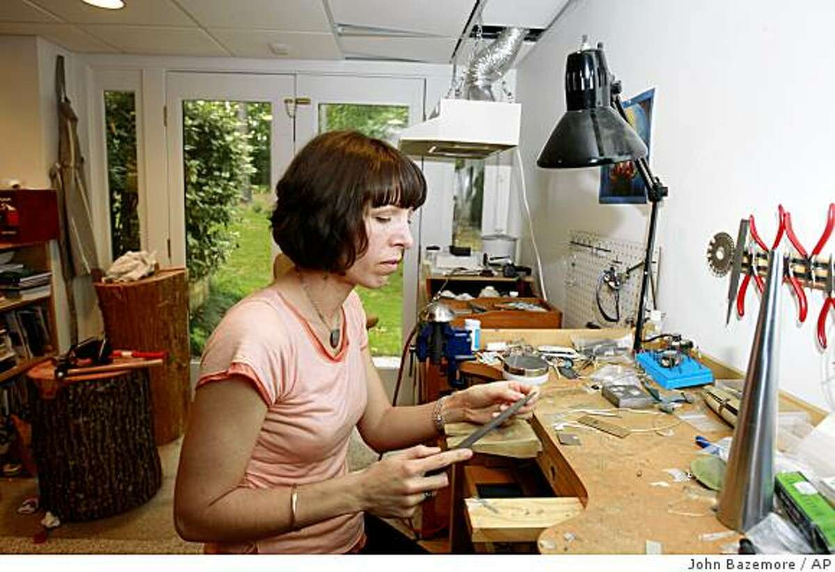In this photo taken Thursday, May 14, 2009, Alicia Istanbul works in her basement studio at her home in Marietta, Ga. Istanbul, a stay-at home mother and jewelry designer, recently had her Facebook account temporarily canceled because of her unusual surname. (AP Photo/John Bazemore)