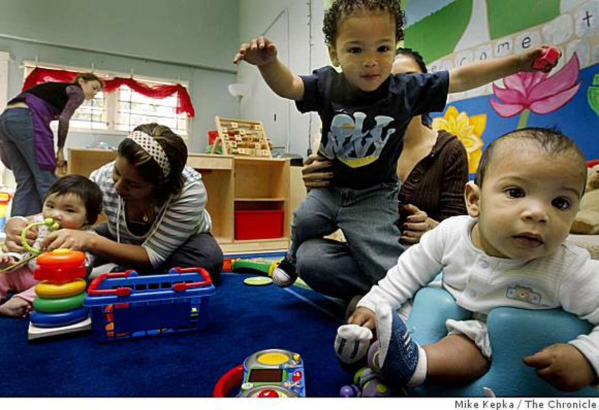 As Claudia Thach (left) monitors her daughter Camila Thach, 6-months, Marisol Curiel holds on to her son Omar Wade-Curiel, 2, as he tries to get closer to his little brother Idan Wade-Curiel, 6 months, during a multicultural playgroup session at the Lotus Bloom Child & Family Resource Center on Wednesday May 13, 2009 in Oakland, Calif. The fastest-growing segments of the Bay Area's population are Latinos and Asians and Alameda County has the second largest number of minority children in the Bay Area under the age of four.