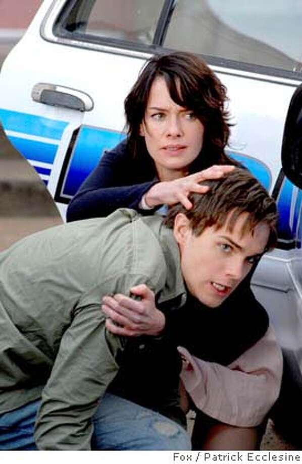 "**ADVANCE FOR WEEK OF SUNDAY JAN 13-SATURDAY JAN. 19** In this photo released by Fox, shows a scene from ""Terminator: The Sarah Connor Chronicles"" with Sarah Connor (Lena Headey), left and her son John (Thomas Dekker) find themselves in a dangerous and complicated new world in the new drama premiering Jan. 13 and Jan 14. (AP Photo/Patrick Ecclesine,FOX) Photo: PATRICK ECCLESINE"