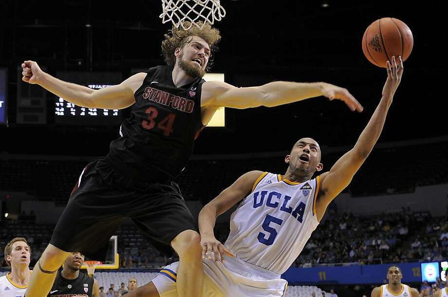 UCLA guard Jerime Anderson, right, puts up a shot as Stanford forward Andrew Zimmermann defends during the second half of their NCAA college basketball game, Thursday, Feb. 9, 2012, in Los Angeles. UCLA won 72-61. Photo: Mark J. Terrill, Associated Press
