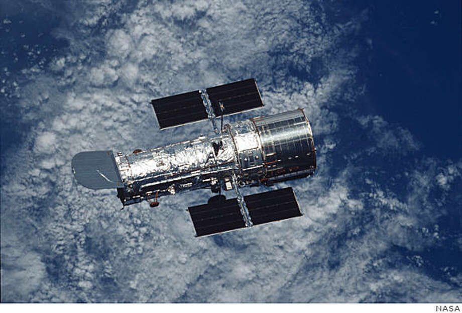 The Hubble Space Telescope floats against the background of Earth after a week of repair and upgrade by Space Shuttle Columbia astronauts in 2002. Hubble�s fourth servicing mission gave the telescope its first new instrument installed since the 1997 repair mission � the Advanced Camera for Surveys. It doubled Hubble�s field of view and records information much faster than Hubble�s Wide Field and Planetary Camera 2. Photo: NASA