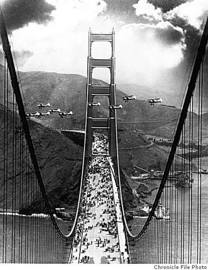 GGBRIDGE-B-1937-MN-CHRONICLE - Opening day of the Golden Gate Bridge, 1937. Pedestrians walk on the brdige, while planes fly between the North and South Towers of the bridge during opening day.  Chronicle File Photo Photo: Chronicle File Photo, Sfc