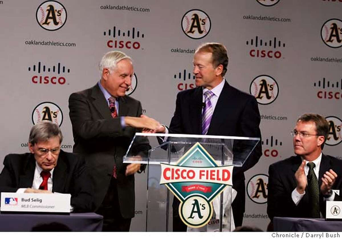 athletics14_001_db.JPG Athletics Co-owner and Managing partner, Lew Wolf shakes hands with Cisco Chief Operating Officer, John Chambers, right center, as Major League Baseball Commissioner, Allan H. (Bud) Selig, left, and A's president, Michael Crowley, right look on while they unveil the new Cisco Field logo (front center on podium) for the team to be moved to Fremont, at an Oakland Athletics press conference at Cisco Systems in (cq) in San Jose, CA, on Tuesday, November, 14, 2006. 11/14/06 Darryl Bush / The Chronicle ** Lew Wolf, John Chambers, Allan H. (Bud) Selig, Michael Crowley (cq) MANDATORY CREDIT FOR PHOTOG AND SF CHRONICLE/NO SALES-MAGS OUT