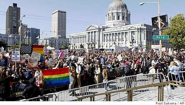 Gay rights supporters rally in front of San Francisco City Hall in San Francisco, Tuesday, May 26, 2009. The state Supreme Court upheld a voter-approved ban on same-sex marriage Tuesday, but also decided that the estimated 18,000 gay couples who wed before the law took effect will stay married. Photo: Paul Sakuma, AP