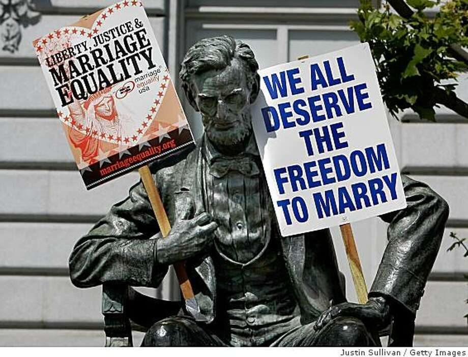 SAN FRANCISCO - MAY 26:  Signs supporting same-sex marriage are seen on a statue of Abraham Lincoln outside of San Francisco City Hall May 26, 2009 in San Francisco, California. The California State Supreme Court voted 6-1 to uphold proposition 8 which makes it illegal for same-sex couples to marry in the state of California. More than 18,000 same-sex couples that wed before prop 8 was voted in will still be legally married.  (Photo by Justin Sullivan/Getty Images) Photo: Justin Sullivan, Getty Images
