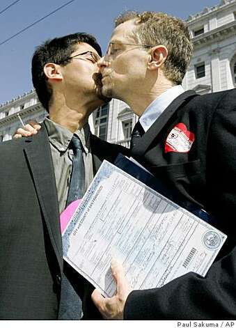 Married same sex couple John Lewis, right, and Stuart Gaffney, right, kiss as they hold their marriage certificate in San Francisco, Tuesday, May 26, 2009. The state Supreme Court upheld a voter-approved ban on same-sex marriage Tuesday, but also decided that the estimated 18,000 gay couples who wed before the law took effect will stay married. Photo: Paul Sakuma, AP