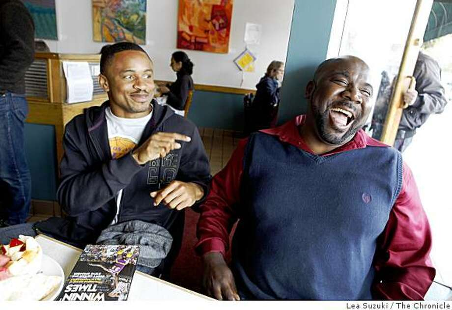 Raiders cornerback Nnamdi Asomugha (l to r) shares a laugh with East Bay prep coach Alonzo Carter at the Rockridge Cafe in Oakland, Calif. on Sunday, May 24, 2009. Photo: Lea Suzuki, The Chronicle