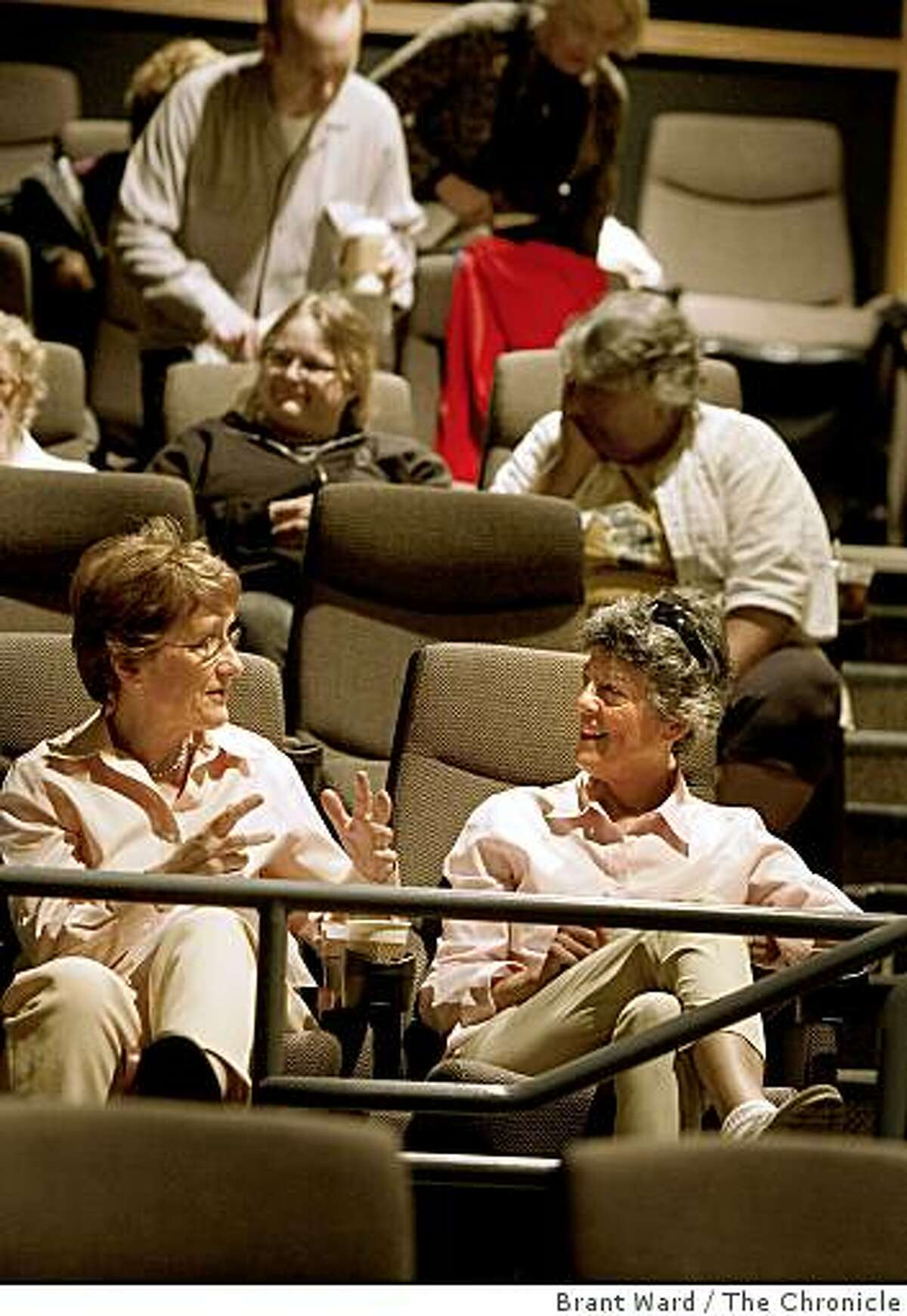 Margaret Anderson (left) and Terry Seligman find some good seats in the balcony and talk before the screening. The Keyclub, soon to be called the Cinema Club, is for film lovers and meets Sundays at the Sundance Kabuki to screen films, which members have no idea what the title will be.