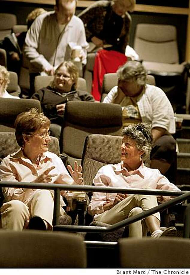 Margaret Anderson (left) and Terry Seligman find some good seats in the balcony and talk before the screening. The Keyclub, soon to be called the Cinema Club, is for film lovers and meets Sundays at the Sundance Kabuki to screen films, which members have no idea what the title will be. Photo: Brant Ward, The Chronicle
